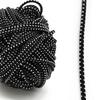 Резинка шляпная 0,25см черная с белыми вкраплениями 1 метр фото