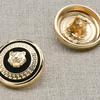 Пуговица металл ПМ11 20мм эмаль черная с золотым львом уп 12 шт фото