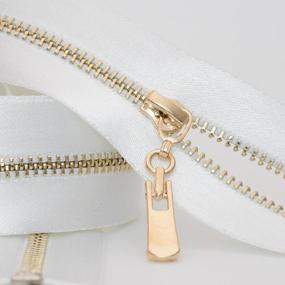 Молния ZZD металл №3 светлое золото н/р 18см D501 белый атлас фото