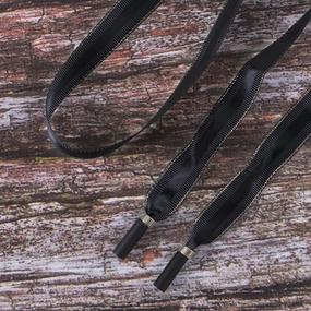 Шнур плоский черный полоса серебро с декор наконечник металл 130см уп 2 шт фото
