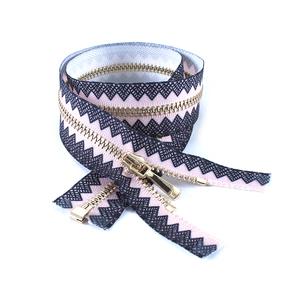 Молния металл №3 светлое золото разъем 50см розовый с черным декором фото