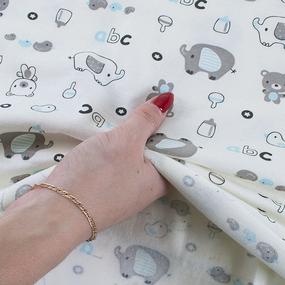 Ткань на отрез интерлок пенье Слоники голубые R089 фото