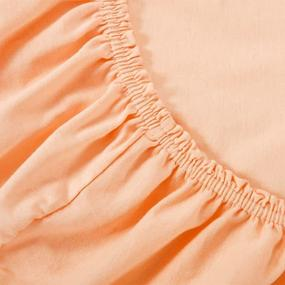 Простыня трикотажная на резинке Премиум цвет персиковый 60/120/12 см фото