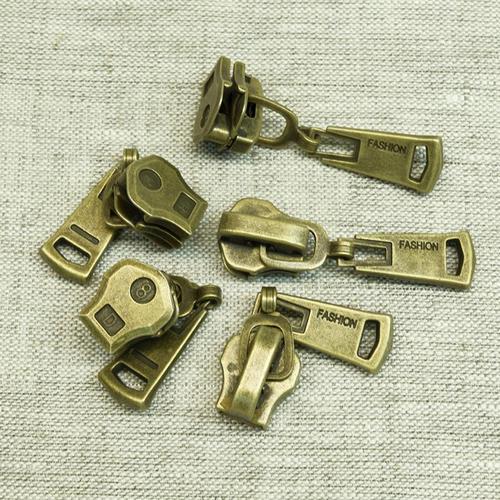 Бегунок металл №8 латунь (антик) фото 1